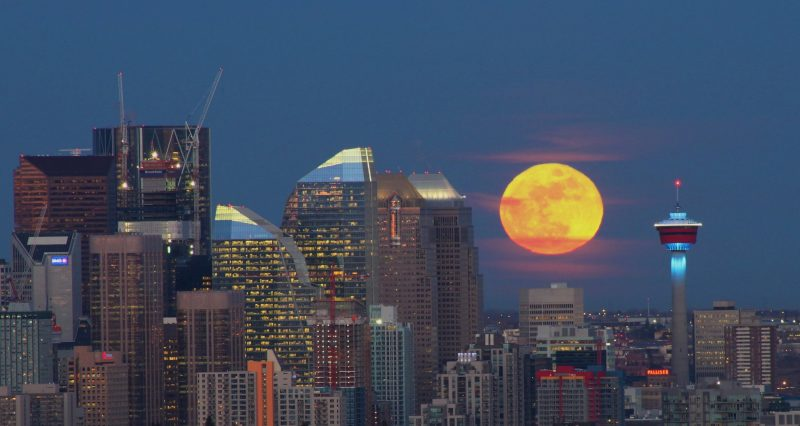 Moonrise over downtown Calgary by Dominic Ma