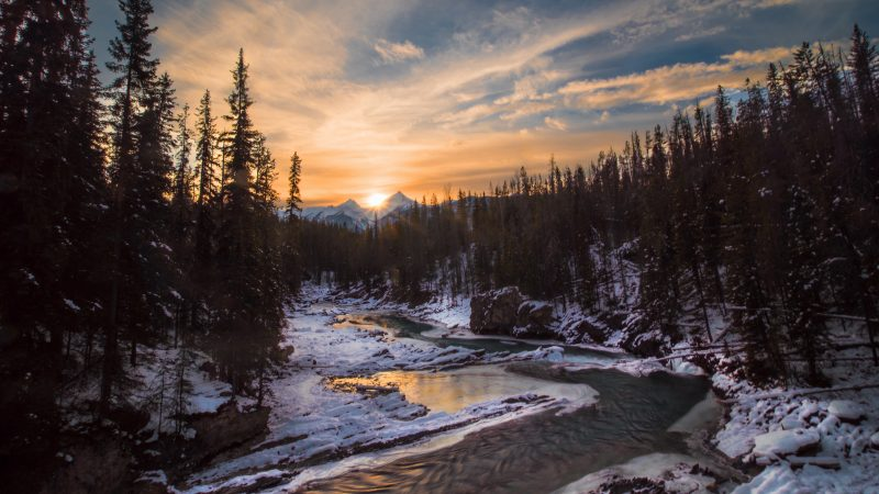 Golden Rays on Icy River